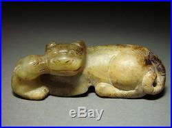 ANTIQUE CHINESE JADE CARVING OF RECUMBENT DOGS, PENDANT. MING DYNASTY 16/17th C