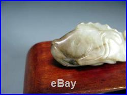 A Chinese Jade Carving Of A Fish With Lotus Yuan Dynasty (1279-1368) Or Later