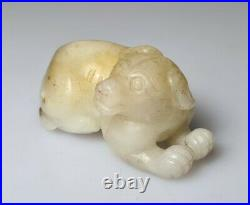 A Fine Qing Dynasty Pale Creamy White Jade Carving Of A Dog