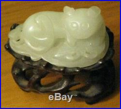 Chinese Carved White Nephrite Jade Cat holding a Bat on carved wooden stand