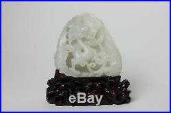 Chinese carved white jade dragon on wood stand, China
