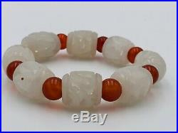 Chinese near white nephrite carved jade and carnelian bracelet