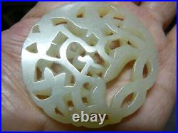 Finely carved Chinese celadon white jade round pendant 19th C or earlier