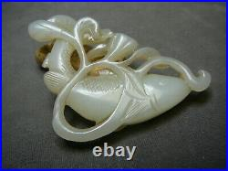 Finely carved Chinese white jade fish swimming amongst lotus buds 18th 19th C